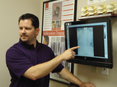 Gary Hagner, D.C. showing chiropractic scans